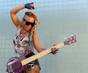 Front and Center: Bassist Divinity Roxx interview by The Women's International Music Networkiew by
